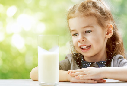 a girl drinking fresh milk