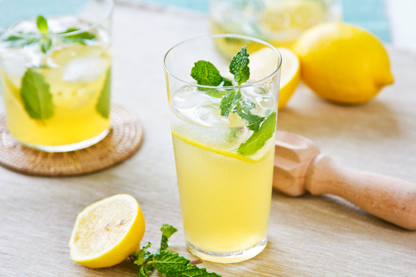 24987045 - lemonade with fresh lemon and mint by lemon reamer