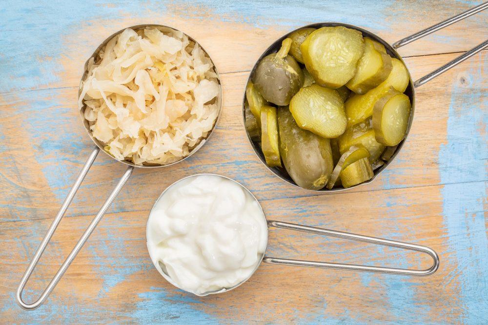 bigstock-sauerkraut-cucumber-pickles-a-109673054-e1469703614649